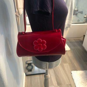Stuart Weitzman Red patent Begonia Handbag.